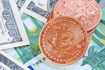 golden bitcoins (new virtual currency) with dollars and euro