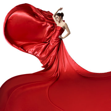 Young beauty woman in fluttering red dress. Isolated on white ba
