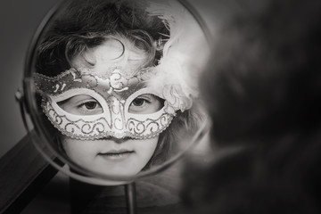 Black and white portrait of a beautiful girl in carnival mask