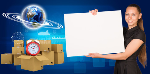 Businesswoman with Earth and heap of cardboard boxes