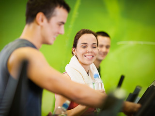Three people training at the fitness club