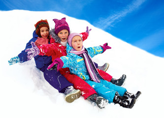 happy children sledding at winter time