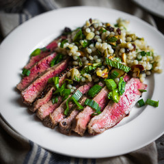 Sliced steak with couscous and vegetables