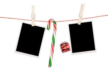 Blank photo frames and candy cane hanging on the clothesline