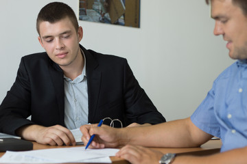 Man signing a purchase agreement