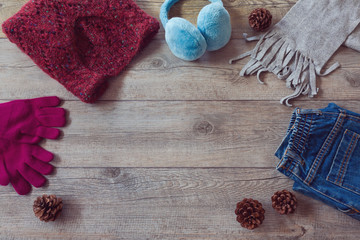Winter clothes on wooden background