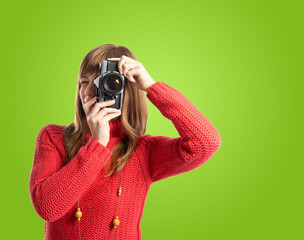 Woman photographing over green background