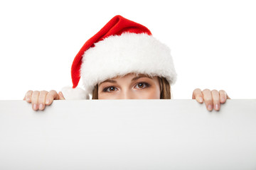 Christmas woman in santa hat holding empty board