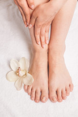 Closeup photo of female feet at spa salon on pedicure procedure.