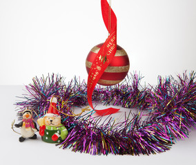 Christmas bauble and decorations with tinsel isolated on white