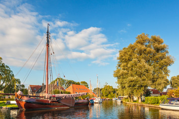 Old sailing boat in the Dutch village Heeg, Friesland