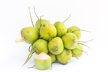 Young coconut fruits on white background