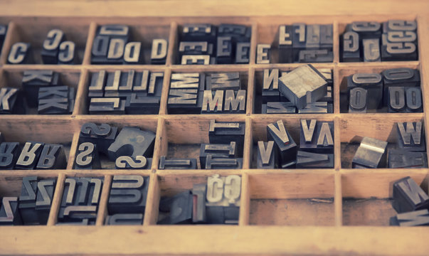 typographical letters in wooden box