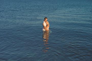 Elegant couple in the sea