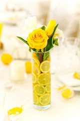 Yellow roses in vase with lemon