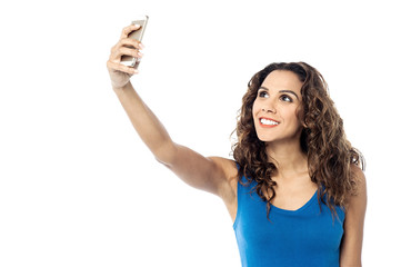 Smiling woman taking photo of herself