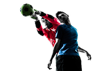 two men soccer player goalkeeper punching heading ball competiti