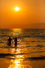 loving couple  at sunset in the sea