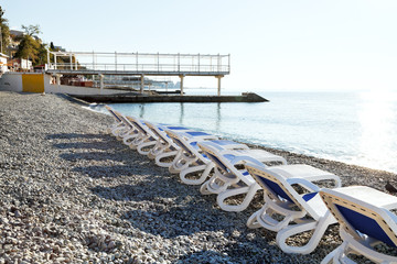 chairs on urban Massandrovskiy pebble beach, Yalta