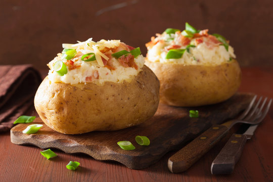 baked potato in jacket with bacon and cheese