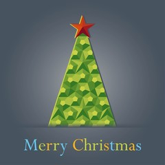 green Christmas tree with a star on gray background greeting car