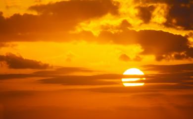 Fotobehang - orange sky with a shining sun