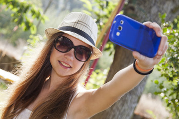 girl taking photos with your phone