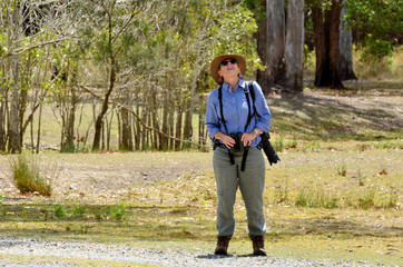 Mature woman birdwatching