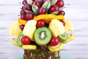 Table decoration made of fruits on grey wooden background