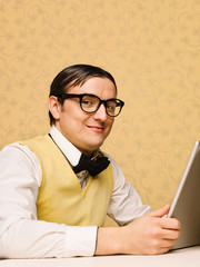 Young nerd sitting at the computer