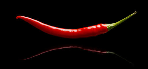 Red pepper, chilli isolated on black background
