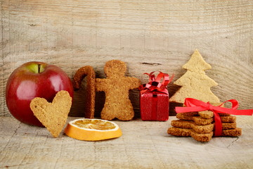Christmas atmosphere scenery with santa claus,apple on wooden