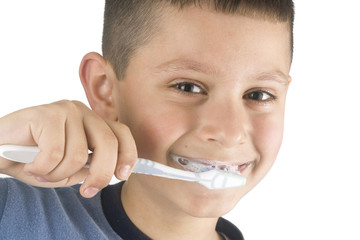 Young boy cleans a teeth a tooth-brush