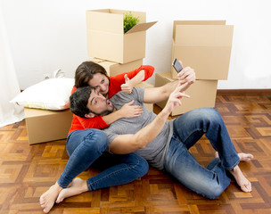 couple moving together in new house taking selfie photo