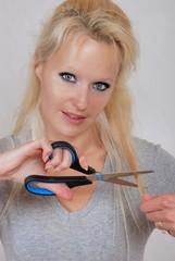 woman cutting hair fringe