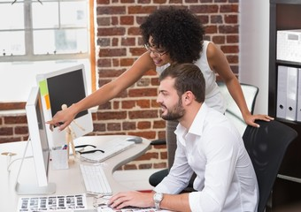 Photo editors using computer in office