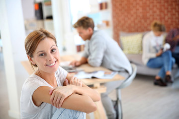 Smiling woman sitting in shared apartment