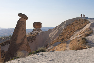The landscape of Cappadocia with tourists