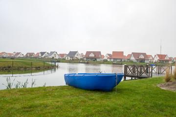 Blue rowboat on the lake on vacation
