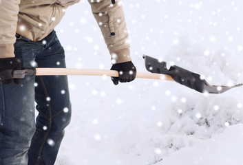 closeup of man digging snow with shovel