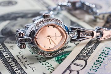 Clock on dollars