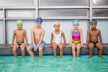 Cute swimming class smiling at camera