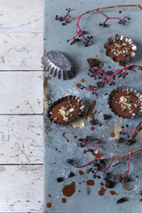 chocolate pastries on vintage molds on table with branches