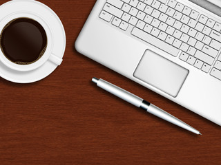 laptop keyboard, pen and cup of coffee on wooden desk