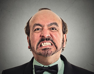 portrait headshot middle aged angry man on grey background