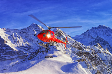 Poster Helicopter Red helicopter landing at swiss ski resort near Jungfrau mountain in Switzerland alps