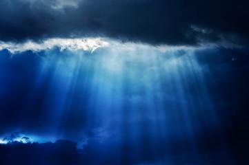 Aluminium Prints Heaven Ray of sunlight pierce a cloud