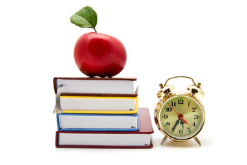 apple, clock and books