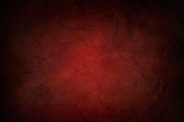 red dirty and wrinkled sheet of paper with black vignette border