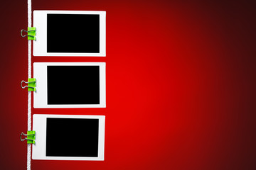 blank photos on red background